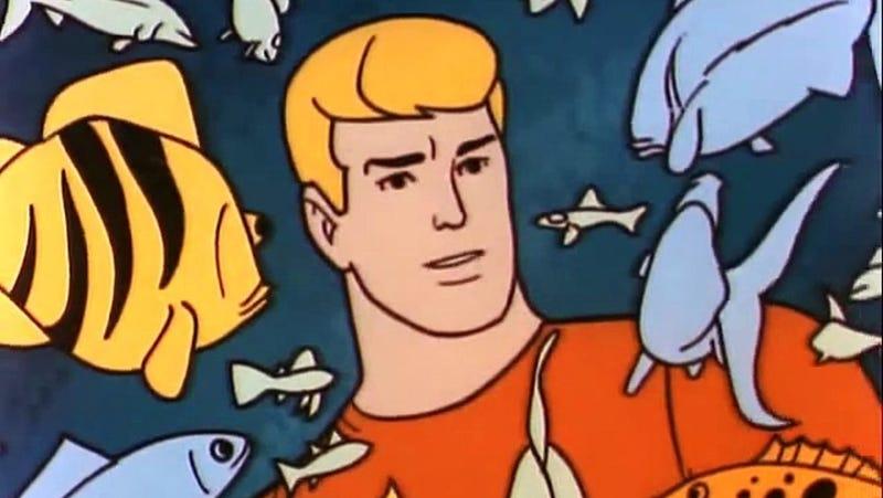 Aquaman having a chat with some aquatic pals.