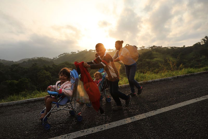 Members of the Central American migrant caravan move to the next town at dawn on November 02, 2018 in Matias Romero, Mexico.