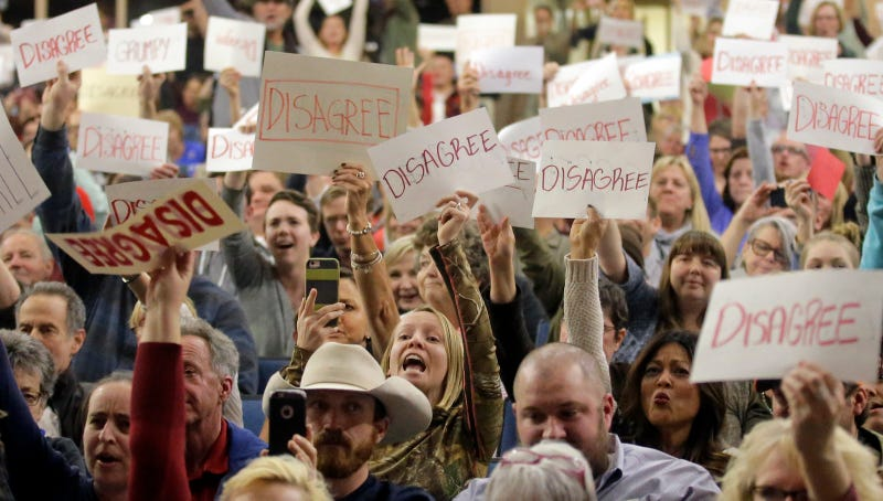 Attendees protest Rep. Jason Chaffetz at a town hall in Cottonwood Heights, Utah on Feb. 9. Image via AP Photo.