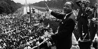 Martin Luther King Jr. waves to the crowd during the 'March on Washington' on Aug. 28, 1963. (AFP/Getty Images)