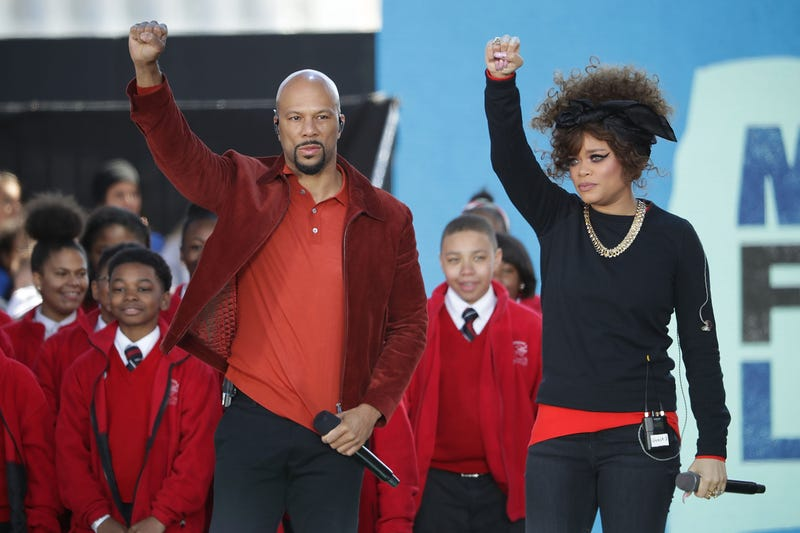 "Common and Andra Day perform ""Stand Up for Something"" with members of the Cardinal Shehan School Choir during the March for Our Lives rally March 24, 2018, in Washington, D.C."