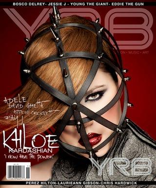 Illustration for article titled A Heavily Photoshopped Khloe Kardashian Does Most Random, Bondage-y, Fashion Cover Ever