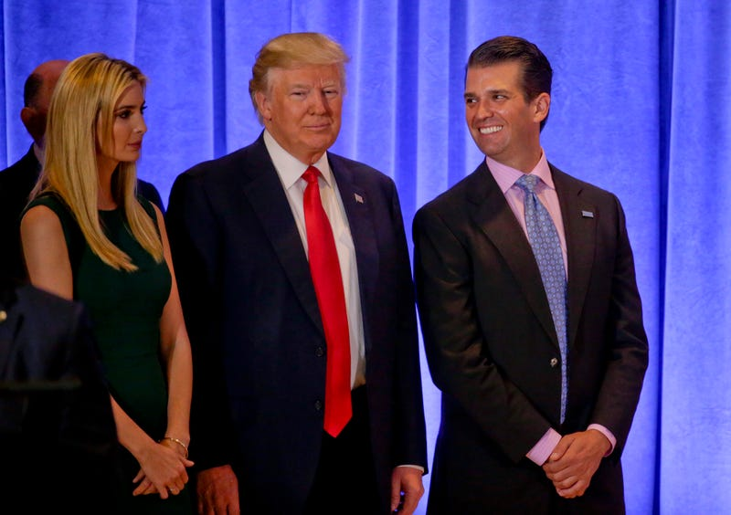Donald Trump Jr. (right) with then-President-elect Donald Trump and Ivanka Trump in New York City on Jan. 11, 2017 (Seth Wenig/AP Images)