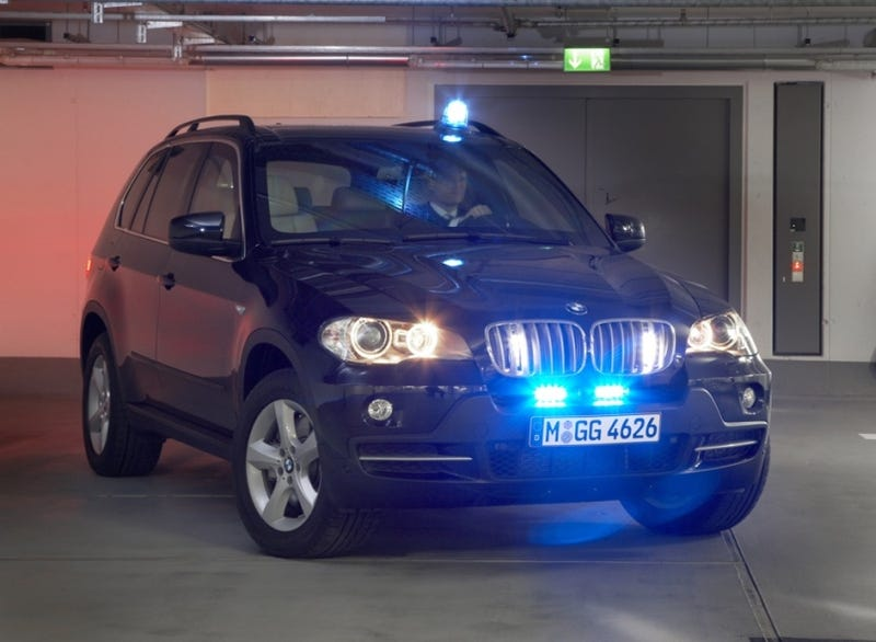Illustration for article titled BMW X5 Security Plus Package: For When Soccer Practice Turns Deadly