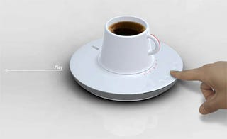 Illustration for article titled Saucer CD Player With Dockable Cup, It Could Happen!