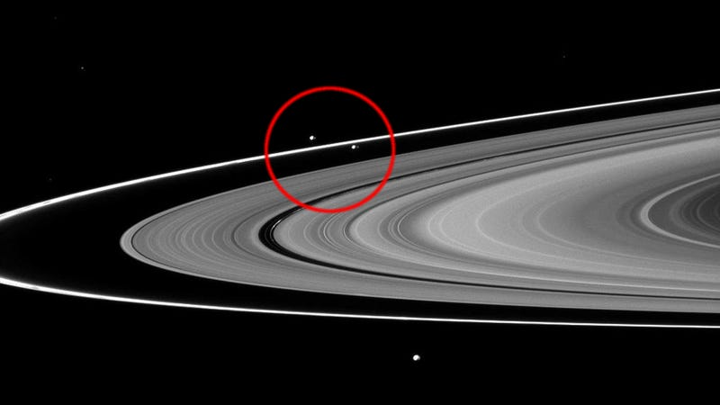 Illustration for article titled These Two Moons Smashed Together to Produce Saturn's Unusual F Ring