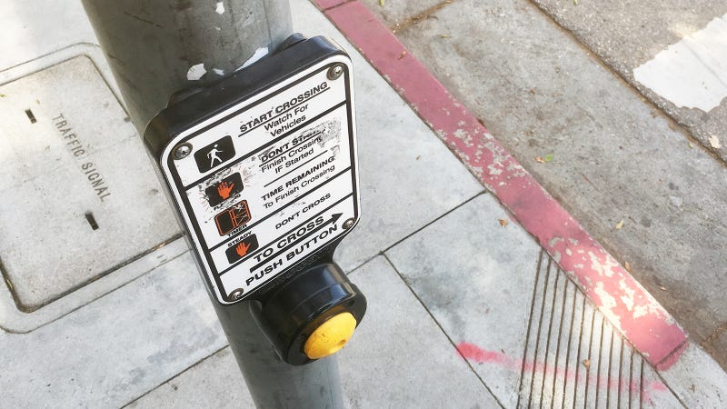 Illustration for article titled The Crosswalk Button Must Be Pressed Many Times
