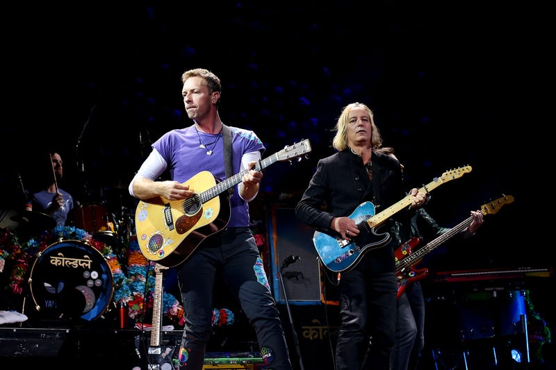 "Peter Buck joins Coldplay on stage to perform ""Free Fallin'"" in a tribute Tom Petty at Moda Center on October 2 in Portland, Oregon. (Photo: Jackie Butler/Getty Images)"