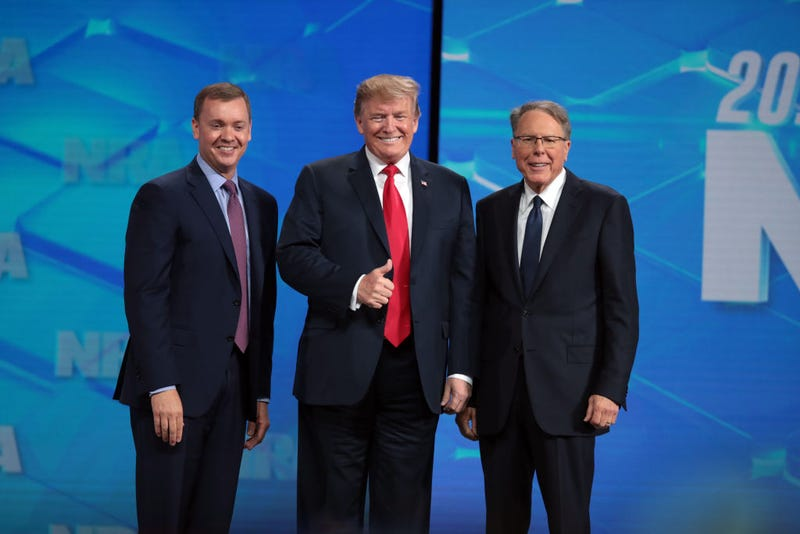 President Donald Trump with NRA Executive Vice President Wayne LaPierre, right, and Executive Director NRA-ILA Chris Cox, left, at the 148th NRA Annual Meetings & Exhibits on April 26, 2019, in Indianapolis.