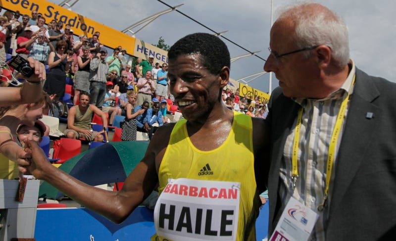 Jos Hermens and the most famous runner he represents, Haile Gebrselassie. Photo credit: Peter Dejong/AP