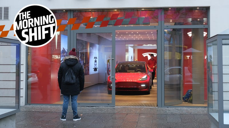 A man in Berlin stares at the Model 3.