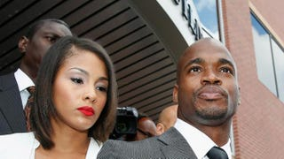 Adrian Peterson of the Minnesota Vikings waits with his wife, Ashley Brown, after making a court appearance at the Montgomery County municipal building on Oct. 8, 2014, in Conroe, Texas. A tentative trial date was set for Dec. 1. Peterson is facing charges of reckless or negligent injury to a child.Scott Halleran/Getty Images