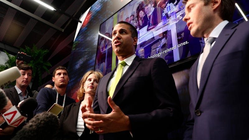 FCC Chairman Ajit Pai, center, attends a press conference at the Mobile World Congress wireless show, in Barcelona, Spain, on Feb. 26, 2019.