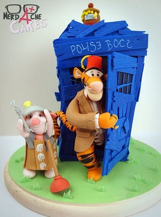 Illustration for article titled Tigger is Eleven and Piglet plays a Dalek in this adorable Doctor Pooh cake