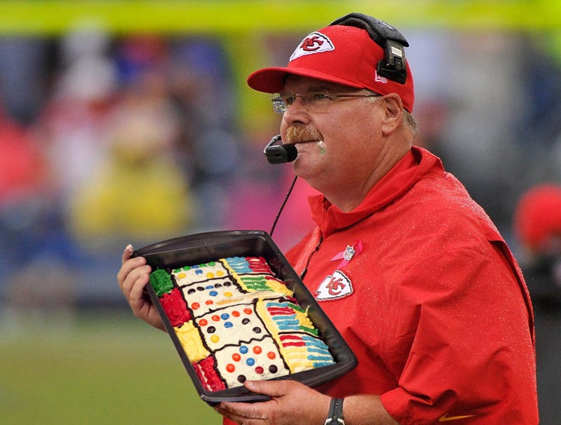 Illustration for article titled Andy Reid Carefully Consulting Chiefs Playcall Sheet Cake