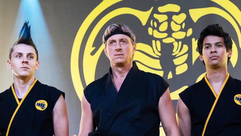 Johnny Lawrence (Billy Zabka, center) is flanked by his star pupils Hawk (Jacob Bertrand, left) and Miguel (Xolo Maridueña, right) in Cobra Kai season 2.