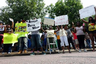 Protesters rally outside the office of St Louis County Prosecuting Attorney Robert McCulloch on Aug. 20, 2014, demanding the arrest of Darren Wilson, the white police officer who shot and killed African-American teenager Michael Brown in the St. Louis suburb of Ferguson on Aug. 9.Robert MacPherson/AFP/Getty Images