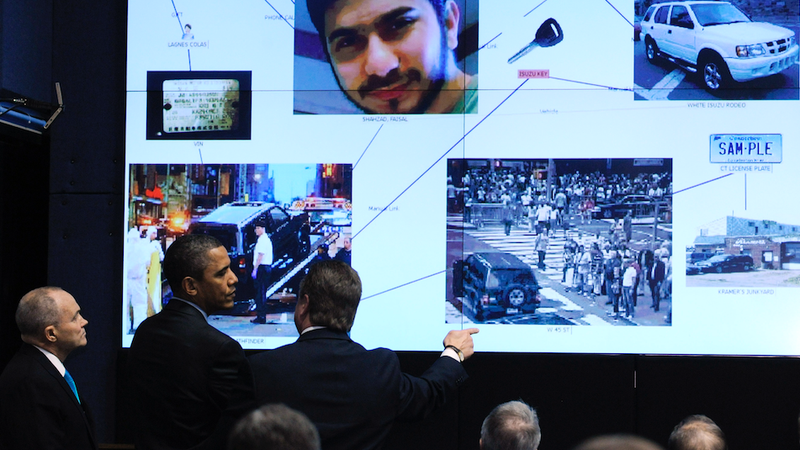Former President Obama at the NYPD's Real Time Crime Center. Faisal Shahzad, car-bomb suspect, is pictured. Photo: AP