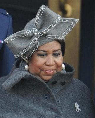 Illustration for article titled Big For Spring: Aretha Franklin's Hat; Katie Holmes' Stirrups