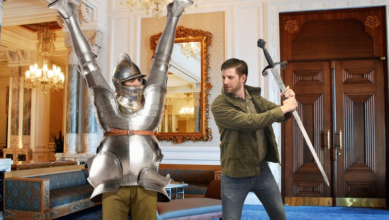 Illustration for article titled 'Hold Still,' Says Eric Trump Swinging Sword At Don Jr. Trapped Inside Knight's Armor