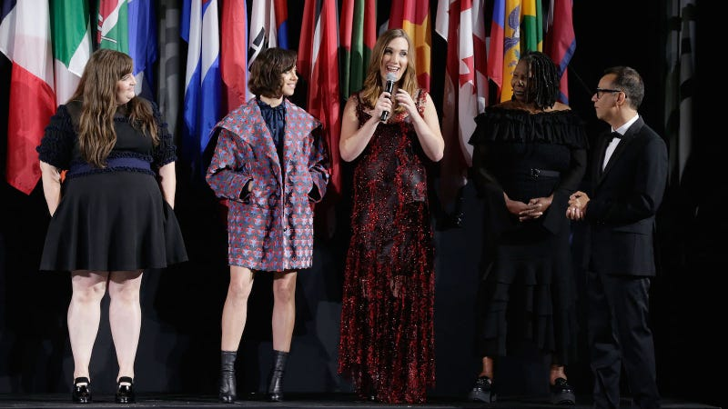 "Aidy Bryant, Aubrey Plaza, Whoopi Goldberg and Fred Armisen listen to transgender actress Sarah McBride at Opening Ceremony's ""Pageant of the People"" presentation on September 11, 2016. Image via Getty."