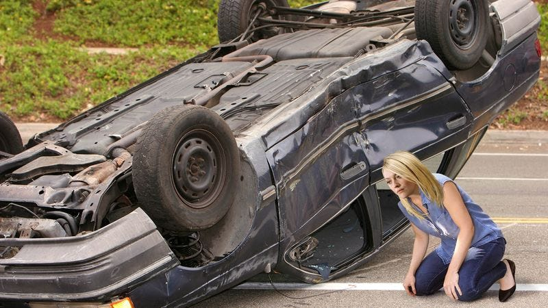 Illustration for article titled Incredible: When She Passed A Couple Trapped In Their Flipped Car, Dakota Fanning Squatted Down And Watched Them