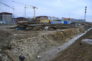 Illustration for article titled Sochi's Olympic Village Is Half-Built and Full of Trash