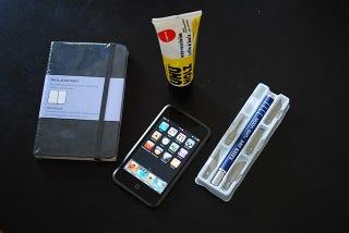 Illustration for article titled Moleskine Sketchbook Turned into iPod touch Case/Reader