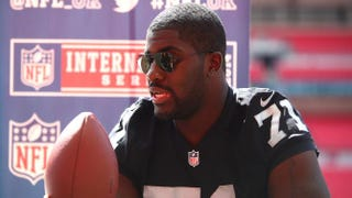 Menelik Watson of the Oakland Raiders speaks during an NFL Media Day at Wembley Stadium in London on July 16, 2014.Charlie Crowhurst/Getty Images