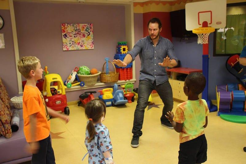Illustration for article titled Studly Teddy Bear Chris Pratt 'Trains Raptors' At Children's Hospital
