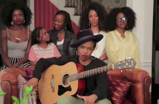 Lauryn Hill (seated) with her daughter Sarah Marley and backup singers YouTube screenshot