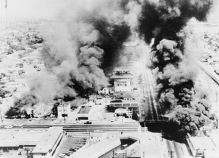Burning buildings during the 1965 Watts riotsWikimedia Commons