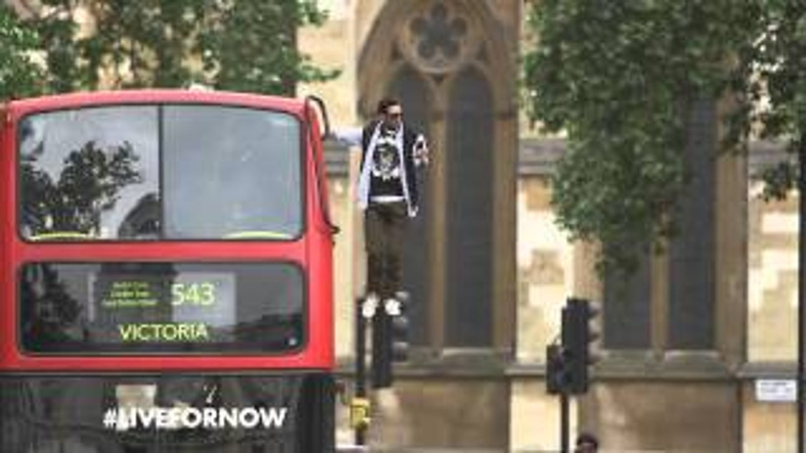 Watch a Guy Freak People Out By Floating in the Air on a Moving Bus