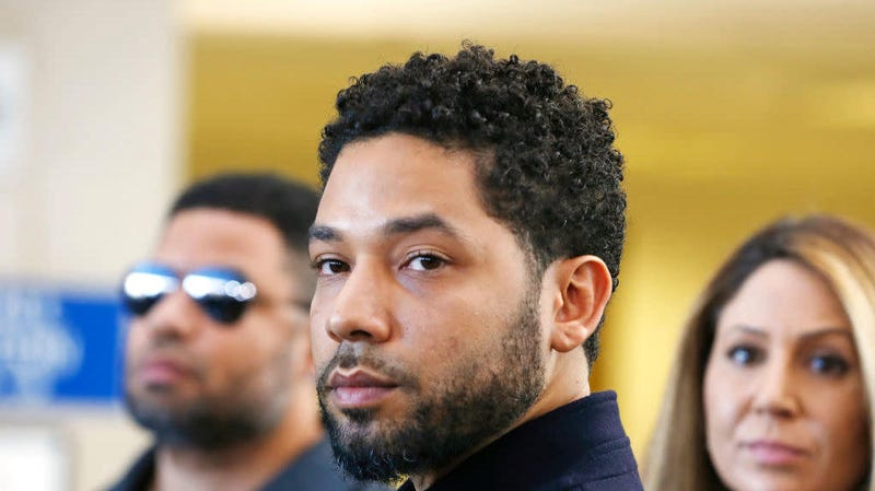 Jussie Smollett after a court appearance in Chicago, March 26, 2019. Prosecutors' decision to drop all of his felony disorderly conduct charges has lawyers in the case of woman facing a similar charge asking why prosecutors want to treat her differently.