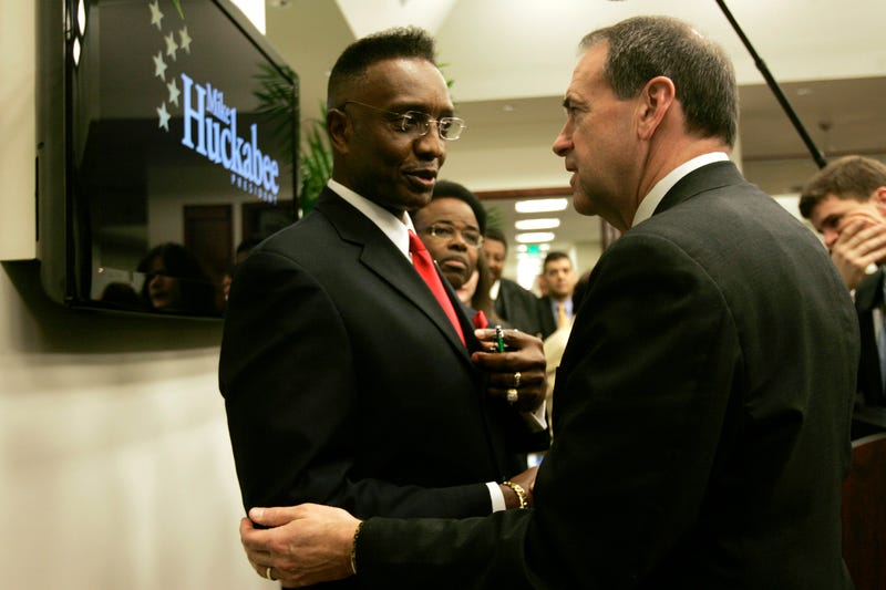 Republican presidential hopeful and former Arkansas Gov. Mike Huckabee talks to the Rev. O'Neal Dozier, pastor of the Worldwide Christian Center, during a campaign stop in Fort Lauderdale, Fla., on Jan. 25, 2008. (J. Pat Carter/AP Images)