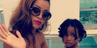 Rihanna and an unidentified child (Instagram via Clutch magazine)