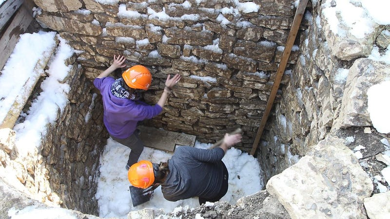 Archaeologists working in a shaft at Augusta Raurica.