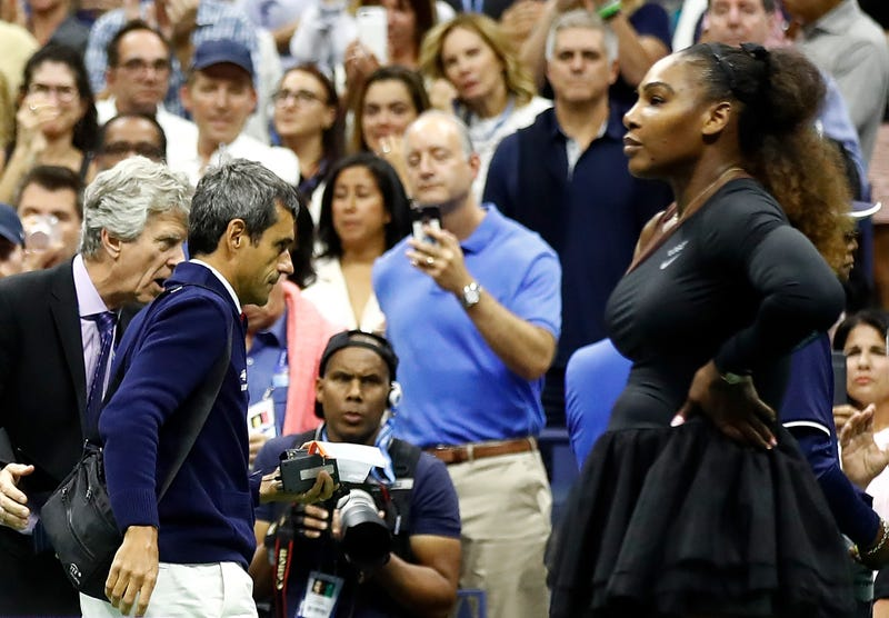 Serena Williams reacts to her loss to Naomi Osaka in the Women's Singles finals match of the U.S. Open as umpire Carlos Ramos (center) walks off the court.