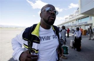 Illustration for article titled Wyclef Defends His Charity, Miley's Not Engaged, And Ricky Gervais Plans To Drink His Way Through The Golden Globes
