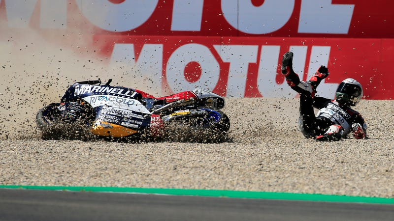 Illustration for article titled Moto2 Rider Who Grabbed Competitor's Brake Lever is Banned From Motorcycle Racing Until 2019