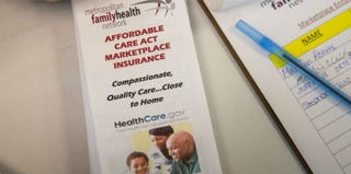 Affordable Care Act pamphlet at Metropolitan Family Health Network, Oct. 3, 2013, Jersey City, N.J. (Andrew Burton/Getty Images)
