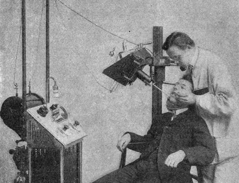 Photo of a dentist working on a patient near an X-ray machine, from the December 1909 issue of Popular Electricity