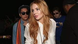 Illustration for article titled Lindsay Lohan Arrested After Crashing Another Porsche Into Another Person