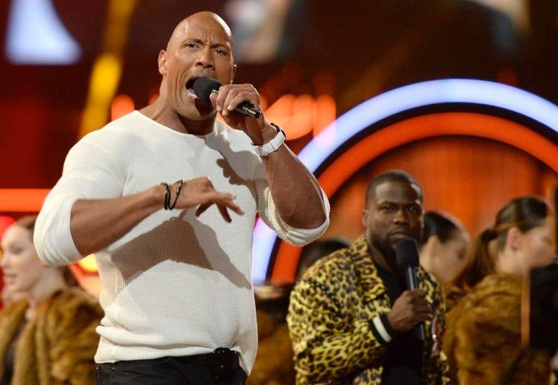 Image: Hosts Dwayne Johnson, left, and Kevin Hart perform at the MTV Movie Awards on April 9, 2016. (Kevork Djansezian/Pool Photo via AP)