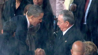 President Barack Obama shakes hands with Cuban President Raúl Castro during the official memorial service for former South African President Nelson Mandela at FNB Stadium Dec. 10, 2013, in Johannesburg.Chip Somodevilla/Getty Images
