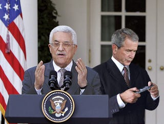Illustration for article titled Bush Texting While Mahmoud Abbas Speaks