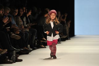 Illustration for article titled Adorable Child Fashion Show Fraught With Inner Grown-Up Conflicts
