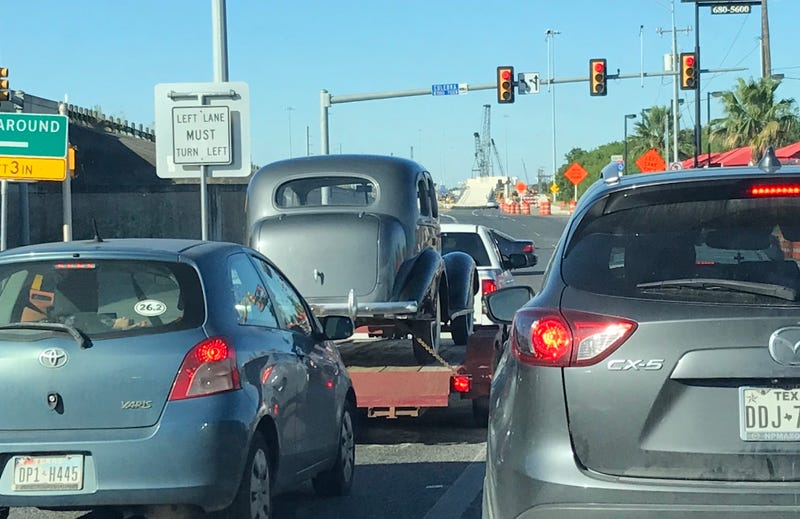 Illustration for article titled What's The Old Car on the Trailer?