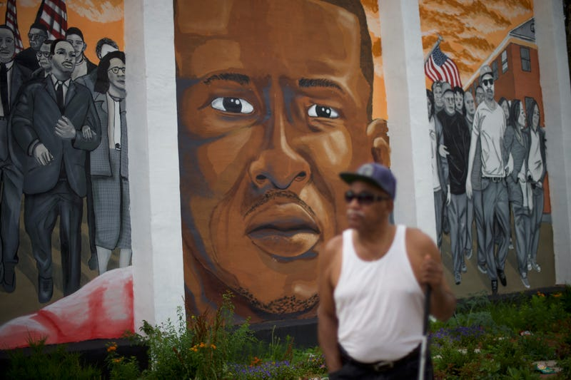 Harold Perry, 75, walks past a mural of Freddie Gray after Baltimore Police Officer Caesar Goodson Jr. was found not guilty of second-degree murder and all charges June 23, 2016, in the case of Freddie Gray, who died while in police custody. (Mark Makela/Getty Images)
