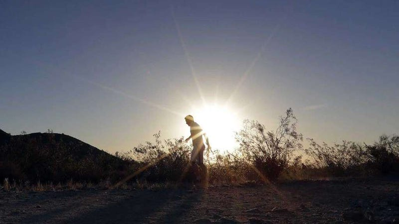 A man runs through South Mountain Park at sunrise to avoid the excessive heat in Phoenix. A record heat wave is rolling into Arizona, Nevada and California, potentially bringing 120-degree temperatures to Phoenix by early next week. (Image: AP/Matt York)